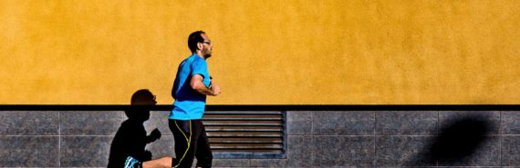 man running past orange wall