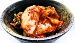 kimchi in stone dish - vegan kimchi