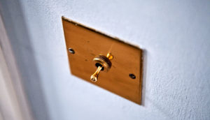 light switch toggle on wall (antibiotics concept)