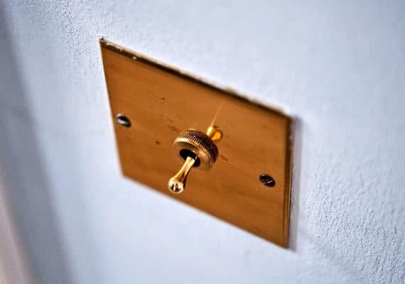 light switch toggle on wall (antibiotics concept)