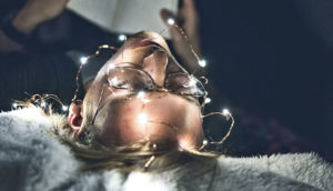 lights on sleeping person (sleep and memory concept)