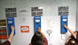 three women use phones in prison - mass incarceration