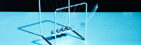 Newton's cradle on blue