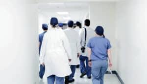 nurses and doctors walking away