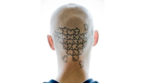 puzzle tattoo on back of head