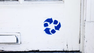 recycling symbol on wall (autophagy concept)