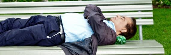 man asleep on park bench - sleep and memory