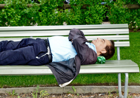 man asleep on park bench - sleep and memory