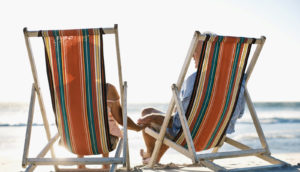 spouses in beach chairs