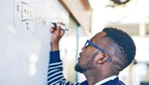 black male teachers at whiteboard
