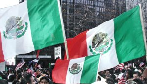 three Mexican flags at rally (Mexican immigration concept)