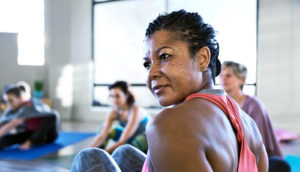 woman in yoga class (exercise and cognition concept)