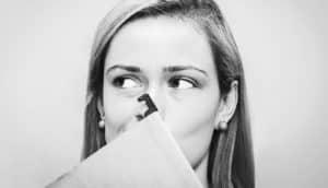 woman making uncomfortable face (unwanted advances concept)