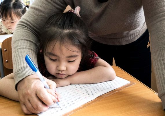 young girl in school (obesity and learning concept)