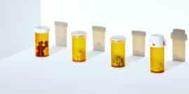 4 pill bottles (opioids concept)