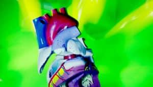model heart on green - pirfenidone