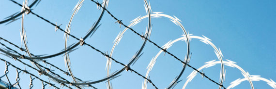 barbed wire fence (prison concept)