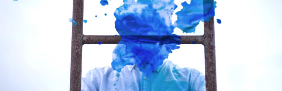 blue blot over face of man on ladder - consciousness