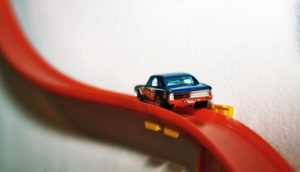 matchbox car on red track - axonal transport