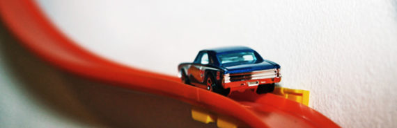 matchbox car on red track - axonal transport