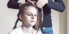 mom braiding daughter's hair (signs of eating disorders)