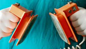 orange defibrillator paddles - tax on medical devices