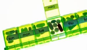 green pill case - biotin supplements