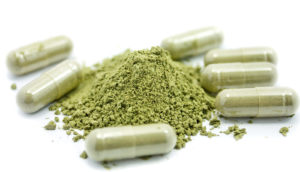 green powder - herbal supplement like Triphala