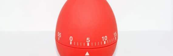 red egg timer on white - productivity