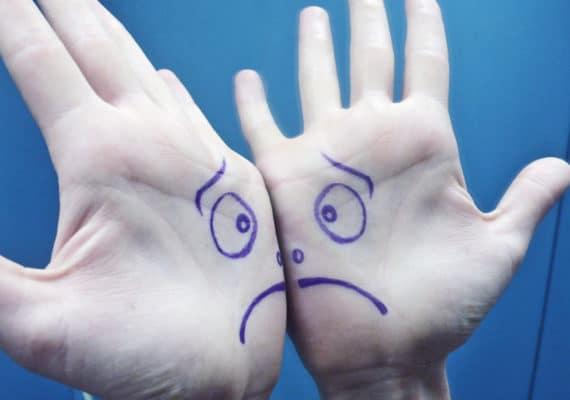 sad face on palms on hands - spanking