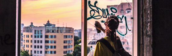 spray painting window in Moscow