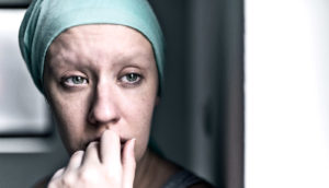 thinking woman with her head wrapped (glioblastoma concept)