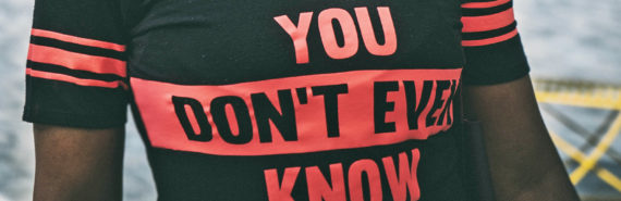 "woman wears ""you don't even know"" t-shirt - breast cancer research"