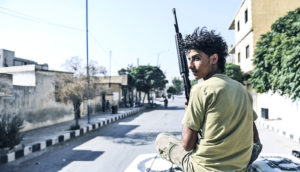 young man in Syria with rifle