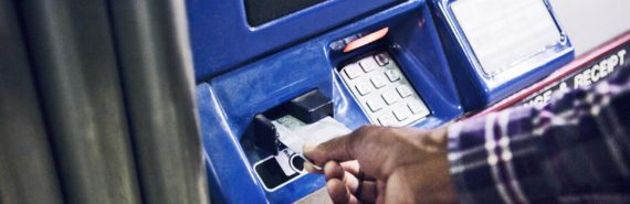 hand puts card into ATM