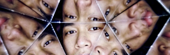 man's face reflected in mirrors
