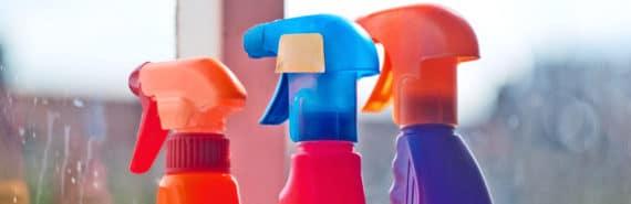 cleaning bottles near dirty window