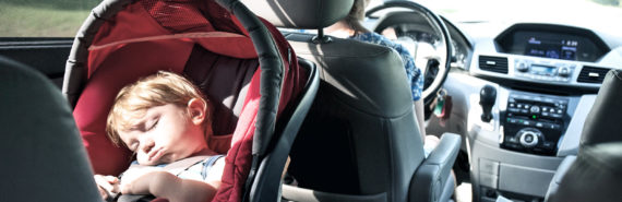 infant sleeping in car (hot cars concept)