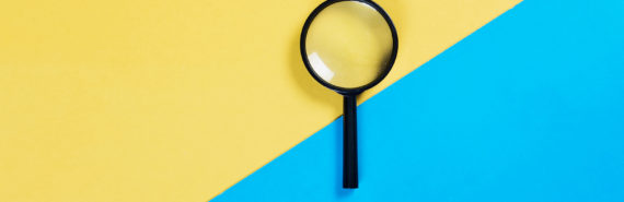 magnifying glass on blue and yellow background
