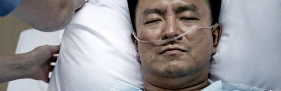 man in hospital bed - catheters