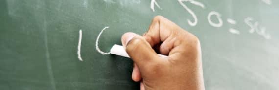 math student at chalkboard (math teachers concept)