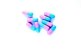 pink blue pills on white (Lou Gehrig's disease concept)