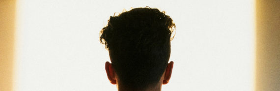 back of man's head in front of patch of light - suicides