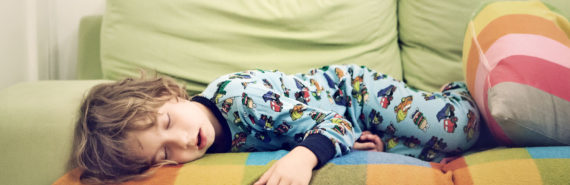 child sleeping on colorful couch - child snoring