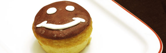 smiley face icing on bun