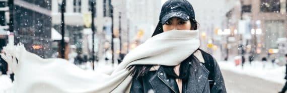 woman wearing scarf in winter city