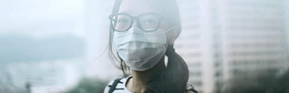 woman through the smog