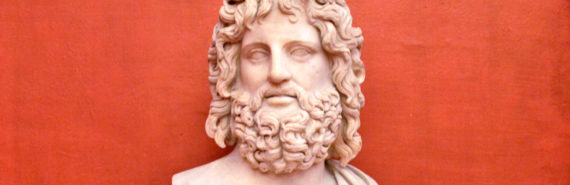 Roman bust of bearded man against red well in Uffizi Gallery