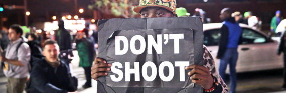 holding 'Don't Shoot' sign in Ferguson (police concept)