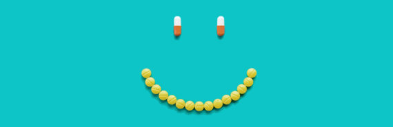 pills in shape of smiley face (side effects concept)